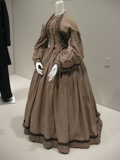 KSMF - Linsey-wooley striped day dress with black braid (to imitate a bolero) (American), circa 1862.