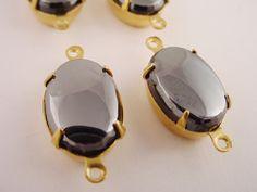 Vintage Hematite Oval Glass Cabs in Brass Prong by brassgoldbeads