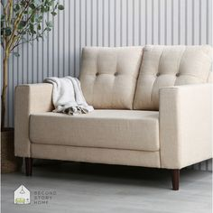 Our midcentury Holloway collection features a beautiful canvas color for those seeking to add some quiet, timeless style to their space. Book Corner Ideas Bedroom, Apartment Living, Living Room, Book Corners, Two Story Homes, Small Places, Mid Century Style, Small Apartments, Architecture Design