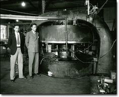 One of the first working accelerators was the Cyclotron at the University of California, Berkeley invented by Ernest Lawrence in 1931, and which built on the ideas of Wideroe. A cyclotron is a type of particle accelerator in which charged particles accelerate outwards from the center along a spiral path. The particles are held to a spiral trajectory by a static magnetic field and accelerated by a rapidly varying (radio frequency) electric field.
