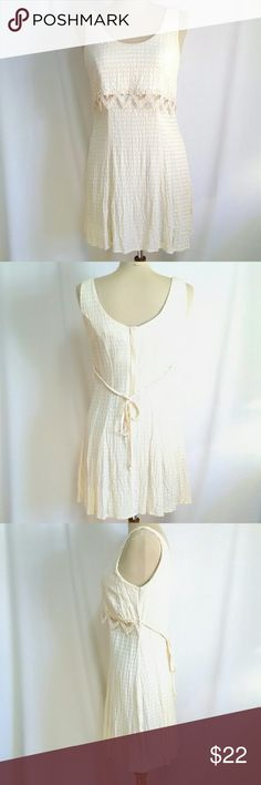 All That Jazz Sundress Cream size 9/10 All That Jazz sundress size 9/10 color cream. Flat lay measurements in inches. Shoulder 13, bust 16, waist 15,  hip 18, hem width 24, length from shoulder to hem 32. This possibly maybe a junior size. Fabric 52% acetate 48% rayon 52%.  Dress does have a little bit of stretch to it.  Excellent condition. The embroidery applique along the front is in perfect condition no rips or holes. All that jazz Dresses Mini