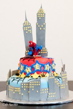 Spiderman on the outside, rainbow cake on the inside.