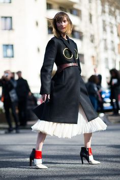 Pinned from Gastro Chic: Anya Ziourova #anyaziourova at #Celine in a Celine coat with inset brass rings - very cool and the first time I've seen this design on the streets. #PFW #streetstyle #fashion