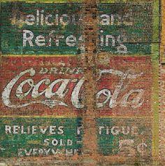 old brick wall advertising