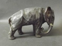 A cold painted bronze figure of a standing elephant, unknown maker