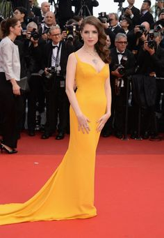 Anna Kendrick wore a brilliant yellow Stella McCartney gown and Bulgari jewels to the Café Society premiere.