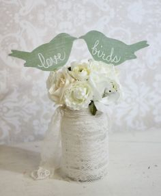 Wedding Cake Topper Love Birds  $28.50, via Etsy. Maybe a center piece with more flowers around it?