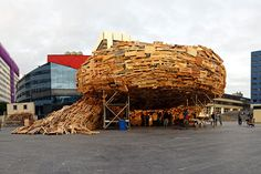 """Raumlaborberlin, propose for """"Todays Art Festival"""" in The Hague, a structure entirely made out of discarded materials, the vortex structure express the idea of a natural force that sucks everything in its path 