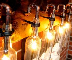 Give your home bar or dining area a touch of style by illuminating it using this wine bottle light lamp. Clear wine bottles hang from a handmade cedar backboard with copper fixtures to give any room a rustic appeal while providing great complementary lighting.