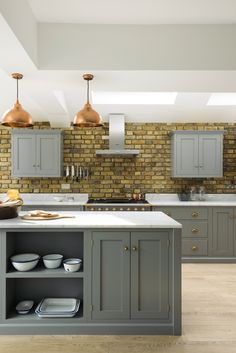 Exposed brick creates a wonderfully rustic vibe in this beautiful Shaker kitchen, whilst sleek Carrara marble worktops and Lead grey cupboards keep the room feeling contemporary and cool. Grey Shaker Kitchen, Shaker Style Kitchen Cabinets, Shaker Style Kitchens, Kitchen Cabinet Styles, Slate Kitchen, Open Plan Kitchen, New Kitchen, Kitchen Dining, Kitchen Ideas