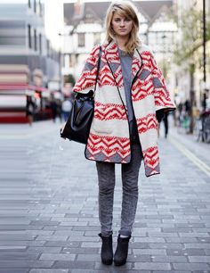 Street style stars are wearing the jumpers as outerwear to fend off the cold weather | ELLE UK