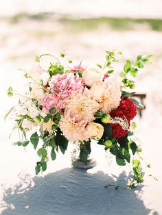 peony + dahlia #centerpiece   Photography: Lauren Kinsey Read more - http://www.stylemepretty.com/2014/01/17/beach-elopement-wedding-inspiration/