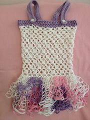 Ravelry: Ruffle Sundress pattern by Leanna Booth It's 12 month size but explains how to change size.