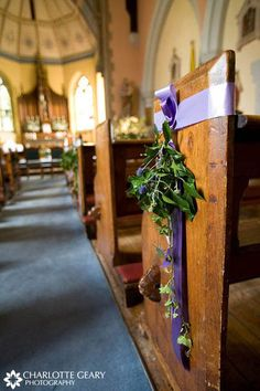 Aisle marker. Purple and green ceremony decorations