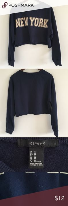 """🆕 Forever 21 Navy """"New York"""" Cropped Sweatshirt These streets will make you feel brand new 🎶   Stats (laying flat): Length: approx. 17""""   Width (pit to pit): approx 23""""   Sleeve Length: approx 25""""   87% cotton, 13% polyester  Pre-owned condition, with some fuzz/lint throughout   machine wash cold   No trades   Save 20% on bundles of 2+ items Forever 21 Tops Sweatshirts & Hoodies"""
