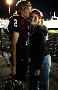 Oh my goodness. My sweet baby Tristan kissing his girlfriend after his varsity football game! Whoa! :O