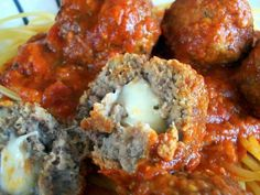 "Mozzarella Stuffed Meatballs  1 lb grnd beef 1 lb grnd mild Italian sausage 1 c breadcrumbs 1 TB Italian season 3 eggs 3 garlic cloves mince 1 tsp salt 1/2 tsp pepp 1/2 lb mozzarella cubed Olive Oil Marinara  In lg bowl mix beef through pepper  Form in 2"" balls  Press cheese cube in middle   seal meat around it Heat 1/2"" olive oil in a large skillet Brown meatballs   set aside Pour marinara into pan  bring to simmer  Add meatballs  simmer for about 30 min Serve over spaghetti or on top of…"