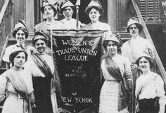 On November 14, 1903 the National Women's Trade Union League was formed. It was organized as a coalition of working-class women, professional reformers & women from wealthy families. Its purpose was to help women secure conditions necessary for healthful & efficient work. In this image, members of the WTUL of New York pose with a banner calling for the 8-hour day. Photo credit: Kheel Center, Cornell University.