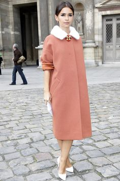 Miroslava Duma at Louis Vuitton, Spring 2013. Elegant peach-colored coat and point-toe heels