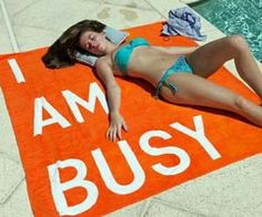 "I Am Busy Towel $ 120.00  Let everyone know you are too busy working on your tan, listening to music, and sipping on pina coladas with these oversized ""I Am Busy"" towels. Designed by Rirkrit Tiravanija, these giant orange towels are perfect for a lazy day at the beach or hangout out poolside."