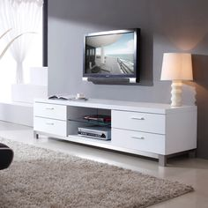 Bring home art-inspired functionality with the B- Modern Promoter TV Stand . With four roomy media drawers, this TV stand offers plenty of space. White Tv Stand Ikea, White Tv Stands, Tv Stand Price, White Tv Cabinet, Swivel Tv Stand, Rack Tv, Tv Stand With Storage, Modern Tv, Console Modern