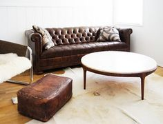 Leather couch, white walls, leather ottoman