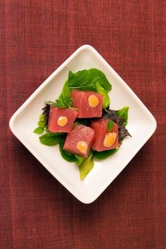 Tuna cubes are dabbed with ginger-apricot aioli. (Photo: John Lei for The New York Times)