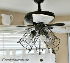 """Hometalk :: How I Gave My Ceiling Fan a Farmhouse Style """".urned my ceiling fan into a rustic farmhouse lighting fixture, using a few Walmart chicken wire baskets and some clearanced wire napkin rings from Hobby Lobby. Rustic Farmhouse Style, Painted Ceiling, Fan Light, Ceiling Fan Makeover, Farmhouse Style Lighting, Farmhouse Style Lighting Fixtures, Ceiling Fan In Kitchen, Farmhouse Style, Light"""