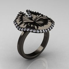 Hey, I found this really awesome Etsy listing at http://www.etsy.com/listing/108391564/18k-black-gold-diamond-water-lily-leaf