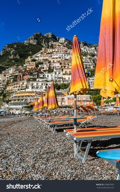 Summer Time In Positano. Yellow Parasols Welcome Holidaymakers In The Resort…