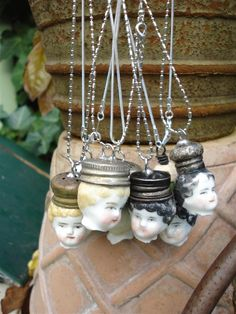 Charlotte doll head pendant. Salt shaker tops.  Never saw anything like this in my life!