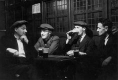 * * September Men drinking in the Prospect of Whitby pub in London. Original Publication: Picture Post - 1230 - A Quiet Evening In A Riverside Pub - pub. 1942 (Photo by Kurt Hutton/Picture Post/Getty Images) Catholic Gentleman, Pub Interior, Catechist, Magazine Pictures, Johnson And Johnson, History Books, Photojournalism, My Photos, Fotografia