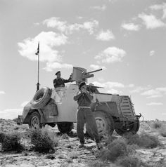 A South African Marmon-Herrington armoured car crew stops to take a compass bearing during a patrol in the Western Desert, 13 April