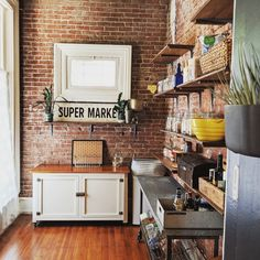 Exposed brick isn't something you see all that often in a kitchen. Whether it's because it's expensive to add into new construction or because most of the old brick walls have been painted over, it's an element we enjoy when we come across it. (Of course, I'm partial to it, given the fact that I have exposed brick in my own kitchen.) We found 18 prime examples of brick at its best in the kitchen — including one kitchen with a brick floor!
