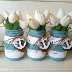 Nautical striped painted mason jars makes a great centerpiece, bath accessory or housewarming gift. These are perfect for baby showers, bridal showers and weddings, parties, and they make cute gifts too!  It includes a rusty anchor, a painted white wooden anchor and a piece of jute twine tied on the jar.  The jar in this listing is a regular mouth, pint sized, Kerr mason jar.  Any florals or photo props shown in the pictures are NOT included.  *Please note: Many of my customers prefer the…