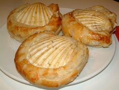 scallops cooking in shells and pastry with white wine, celery, coriander, cumin