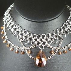 Crystal Copper Chain Maille Necklace  Swarovski by blackbirdmaille. I like the silver/copper combo