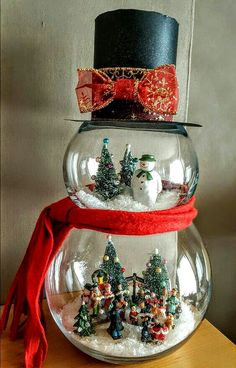 8 Easy DIY Ways To Decorate Your Home For Christmas - Twins Dish : Easy DIY Fish Bowl Snowman. Elegant Christmas Decoration idea for the mantle, table, wedding, party. Great budget decor for the home or apartment. Snowman Christmas Decorations, Snowman Crafts, Christmas Projects, Holiday Crafts, Christmas Ornaments, Christmas Ideas, Snowman Globe Craft, Apartment Christmas Decorations, Diy Christmas Centerpieces