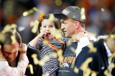 . Peyton Manning #18 of the Denver Broncos holds his daughter Mosley after the Denver Broncos defeated the Carolina Panthers with a score of 24 to 10 to win Super Bowl 50 at Levi\'s Stadium on February 7, 2016 in Santa Clara, California.  (Photo by Sean M. Haffey/Getty Images)