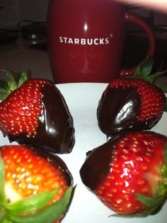 Dark chocolate dipped strawberries and coffee.