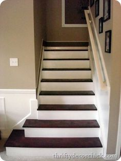 She removed the old carpet off stairs and stained the wood all for $50.  I want to do this.   dark treads light risers stairs