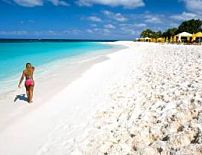 Top 10 caribbean beaches travelchannel eagle beach aruba puerto ricos hidden beaches travelchannel yellow umbrellabeautiful beachmost sciox Image collections