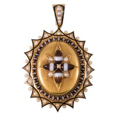 Large Victorian Enamel Banded Agate Pearl Locket. Substantial in size for a Victorian piece, this original yellow gold Victorian locket is designed as a sunburst of pattern created from a symbiotic combination of banded agate, pearls and black enamel. The original glass back is still intact, as is the lock of hair from its former owner's beloved. 2.5 by 1.75 inches. c 1890