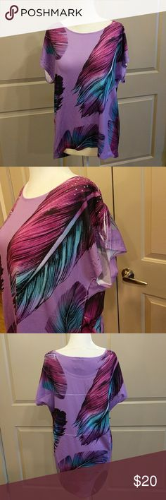 ✨ New Direction peacock feather top Purple short dolman sleeve top from New Direction weekend collection. Has beautiful peacock print with some decorations on the shoulders. In great condition. 23 inches long in front, 29 inches long in the back, 23 inches across at the bust. new directions Tops