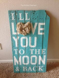 I'll love you to the moon and back wood sign. With burlap looped heart and turquoise background. https://www.facebook.com/ThePickledElephant