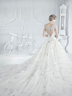Michael Cinco gown. Don't look at the skirt or embellishments. I just like the deep v cut back.