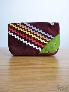 The YUMMY Chocolate Brown RickRack Zippered Pouch by withlovebunny, $16.00