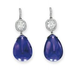 A pair of tanzanite and diamond ear pendants