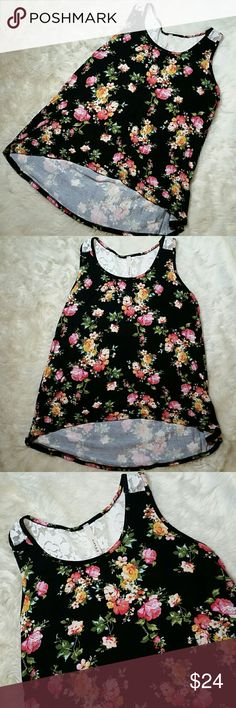 Floral Lace Flowy Hi Low Tank Small Medium Large Floral Lace Flowy Hi Low Tank Small Medium Large. Black tank with all over floral print. Lace panel begins at the back of the straps and continues onto the back below the neckline. Oversized and roomy hi low hemline. Very flowy and flattering. Fits true to size for a relaxed fit that hits slightly below the hips. Made in USA, soft and stretchy 95% rayon & 5% spandex. Available in sizes small, medium and large. Tops Tank Tops