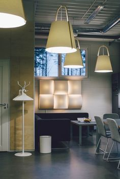 Elegant modern lighting from Sukarwood in Finland. Pendant lamps from the Havukko collection and a wall-mounted lamp from the Sarastus collection.